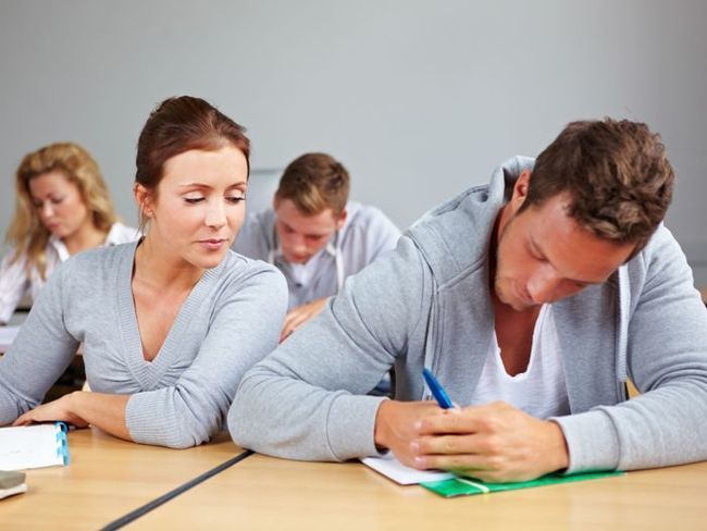10681776 - female student trying to cheat at test in class